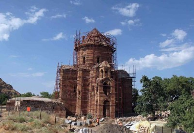 ** file ** the 1,000-year-old akhtamar church, one of the finest surviving monuments of ancient armenian culture, is covered in scaffolding as masons replace fallen roof stones in van province in east turkey, in this july 23, 2005 file photo. after a century of neglect and political wrangling, turkey has restored the ancient church, the lone building on the tiny akhtamar island. turkey may host armenian officials at a ceremony marking the renovation of the chuch, turkish media and sources close to the project said wednesday, march 14, 2007. (ap photo/burhan ozbilici/file)